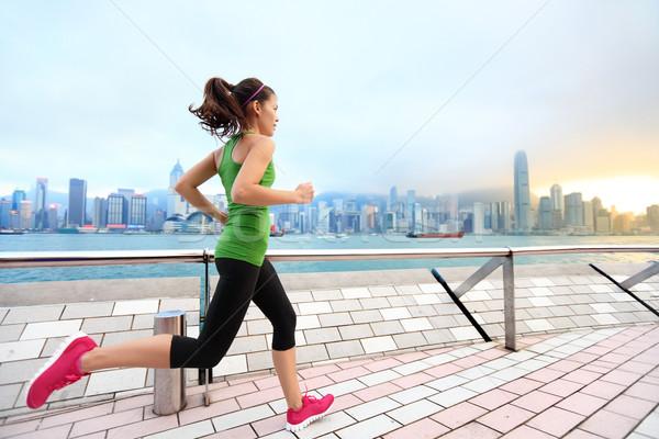 City Running - woman runner and Hong Kong skyline Stock photo © Maridav