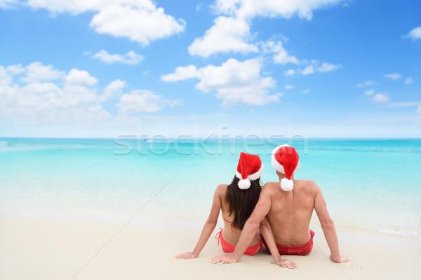 Christmas couple in love on travel beach holidays Stock photo © Maridav