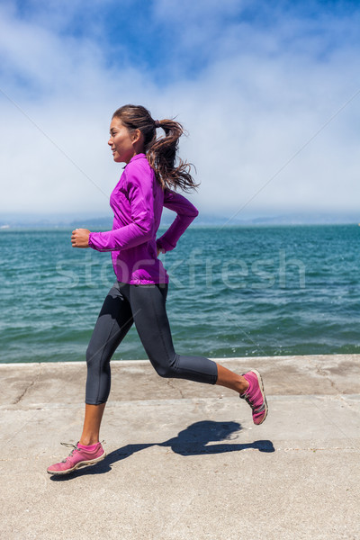 Woman running on waterfront harbour San Francisco Stock photo © Maridav