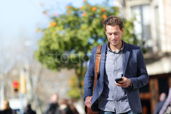 Business person man on mobile phone in city street Stock photo © Maridav