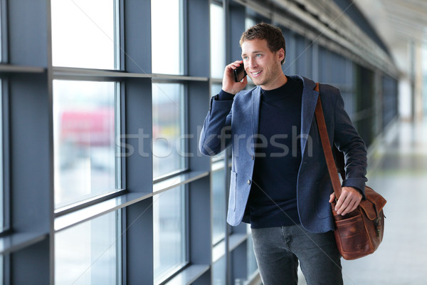 Man talking on phone in airport - travel lifestyle Stock photo © Maridav