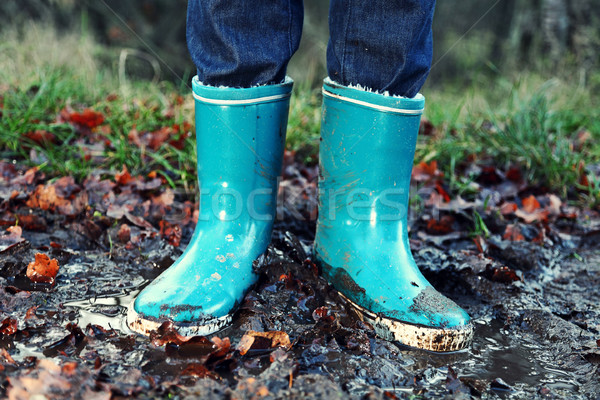 Fall / Autumn concept - Rain boots in mud puddle Stock photo © Maridav
