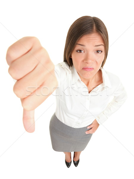 Thumbs down woman Stock photo © Maridav