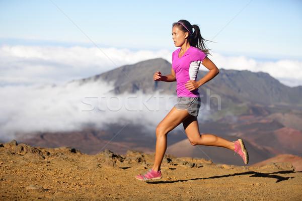 Runner woman athlete running sprinting fast Stock photo © Maridav