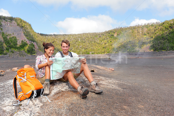 Couple hiking on volcano on Hawaii looking at map Stock photo © Maridav