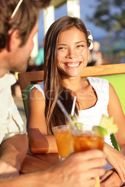 Woman at beach club dating and drinking outdoors Stock photo © Maridav