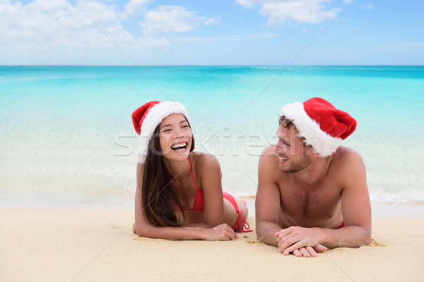 Christmas couple relaxing on beach winter vacation Stock photo © Maridav