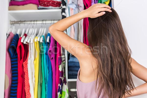 Döntésképtelenség nő választ ruházat szabadság otthon Stock fotó © Maridav
