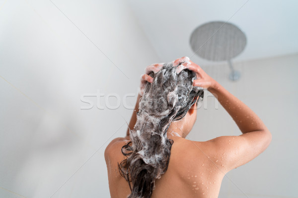 Shower woman washing hair showering in bathroom Stock photo © Maridav