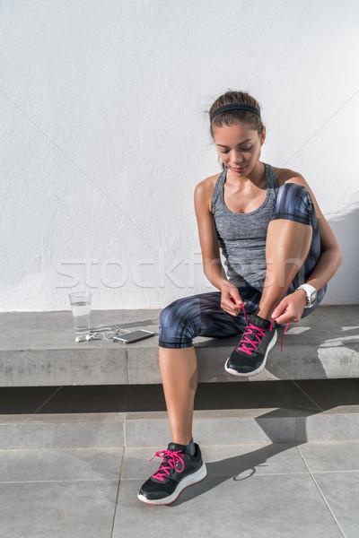 Active woman preparing to run tying running shoes Stock photo © Maridav