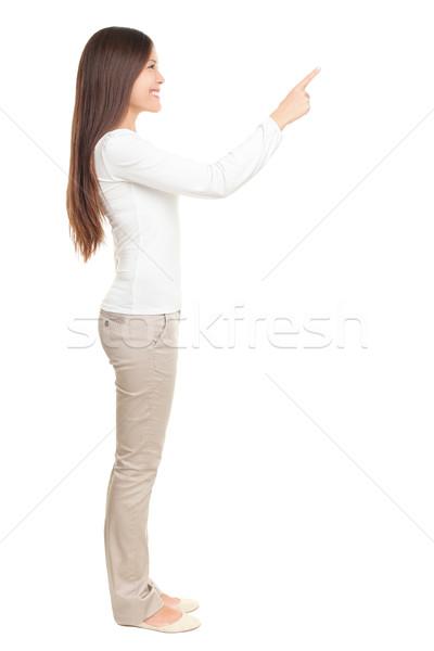 Vrouw wijzend exemplaar ruimte geïsoleerd voortvarend iets Stockfoto © Maridav