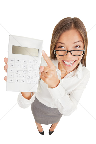 Accountant gleeful woman pointing to a calculator Stock photo © Maridav