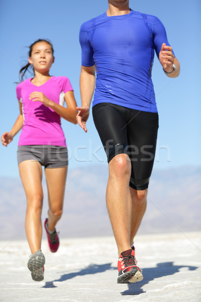 People running - runner fitness couple in desert Stock photo © Maridav