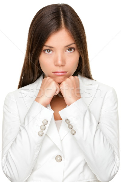 Unhappy Businesswoman With Hands On Chin Stock photo © Maridav