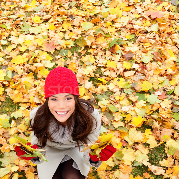 Stock photo: Autumn / Fall leaves background with woman happy