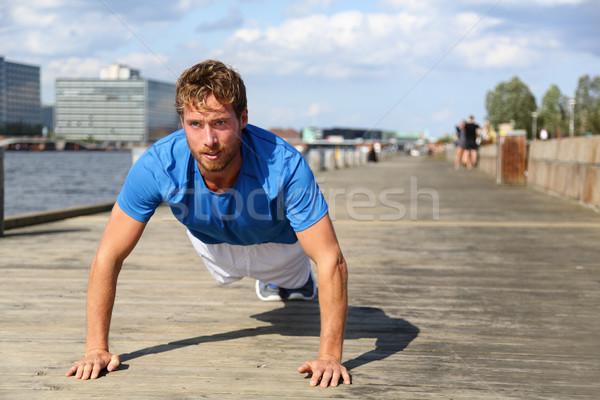 Sport fitness man push-ups Stock photo © Maridav