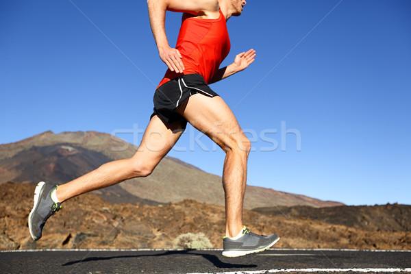 Running man - male runner training outdoors Stock photo © Maridav
