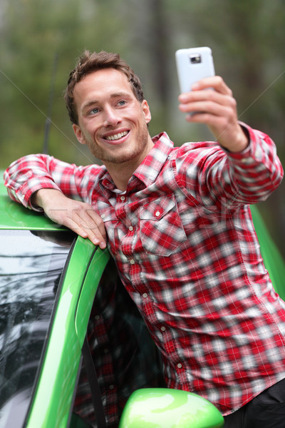 Driver by car taking selfie photo with smartphone Stock photo © Maridav