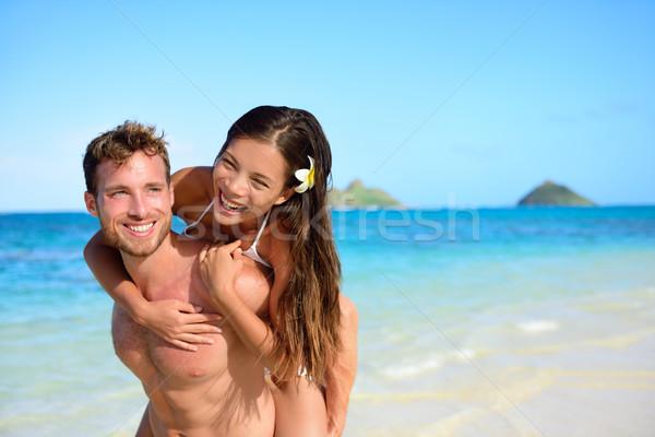 Tengerpart pár vakáció jókedv boldog háton Stock fotó © Maridav