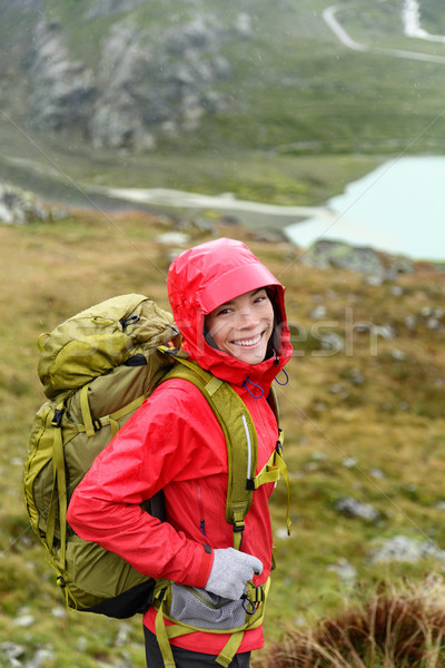 Hiker woman hiking with backpack in rain on trek Stock photo © Maridav
