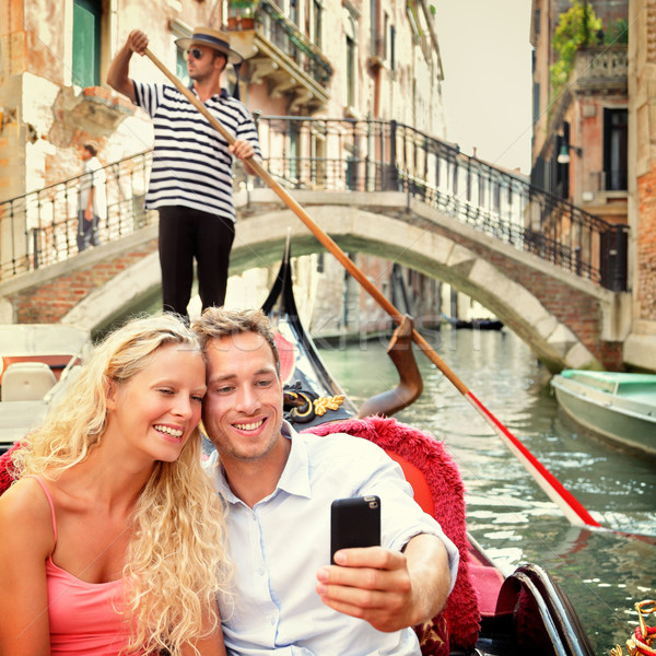 Selfie couple using smartphone in Venice gondola Stock photo © Maridav