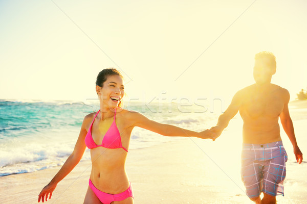 Laughing romantic couple summer vacation beach fun Stock photo © Maridav