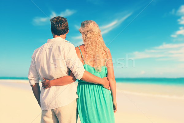 Rear View Of Couple With Arms Around At Beach Stock photo © Maridav