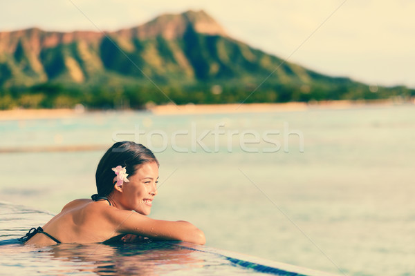 Smiling Woman Relaxing In Infinity Swimming Pool Stock photo © Maridav