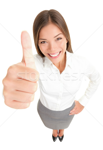 Thumbs up success woman Stock photo © Maridav