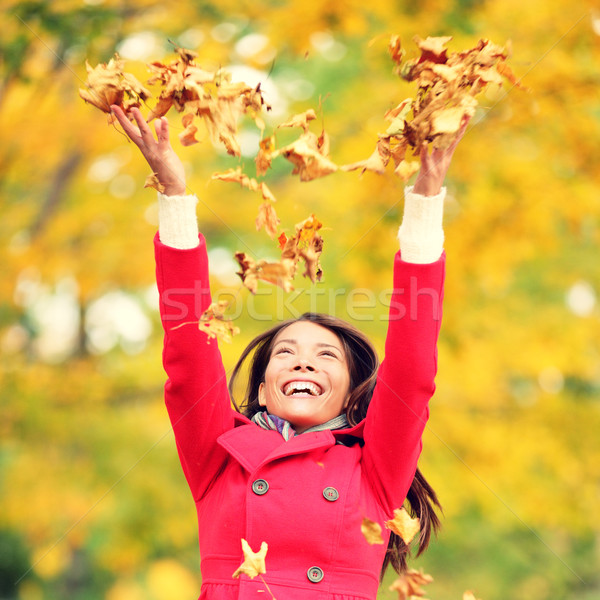 Autumn / fall woman happy throwing leaves Stock photo © Maridav