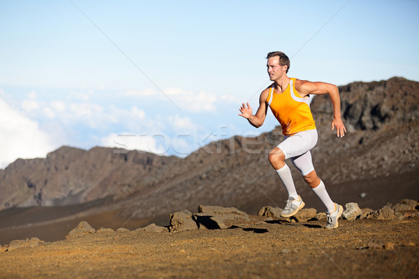 Running sport runner man sprinting in trail run Stock photo © Maridav