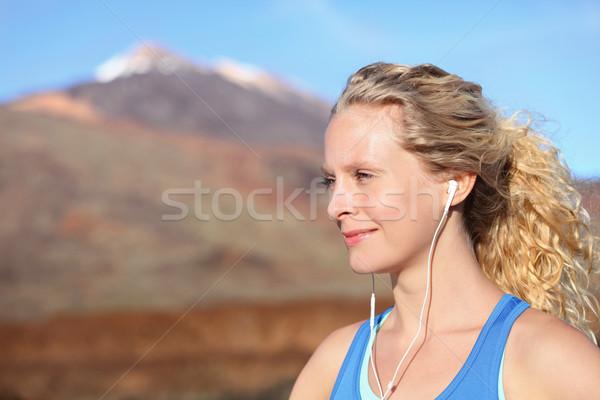 Kopfhörer Frau Läufer Musik hören Ohrhörer Smartphone Stock foto © Maridav