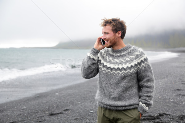 Smartphone man talking on phone on beach, Iceland Stock photo © Maridav