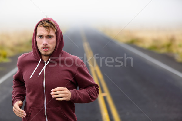 Athlete man running training on road in fall Stock photo © Maridav
