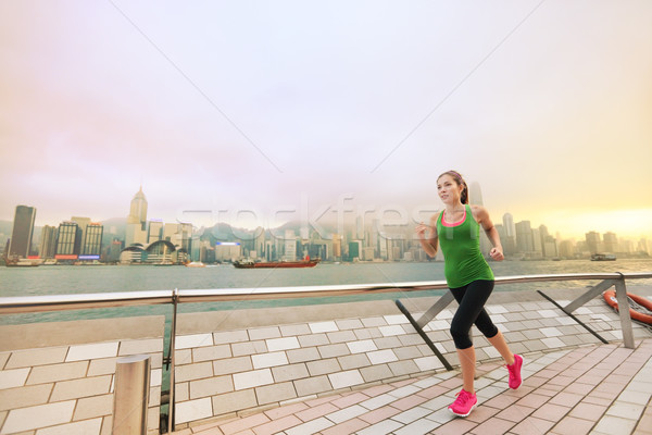 Asian chinese woman runner jogging in Hong Kong Stock photo © Maridav