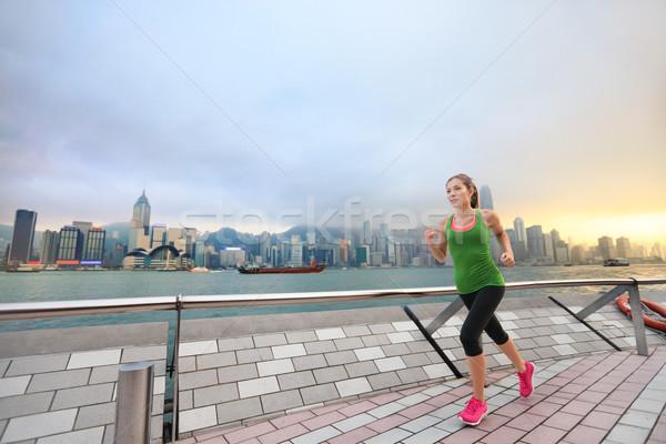 Sport woman jogging in Hong Kong city exercising Stock photo © Maridav