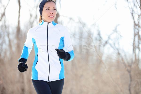 Jonge asian vrouw jogging lopen winter Stockfoto © Maridav
