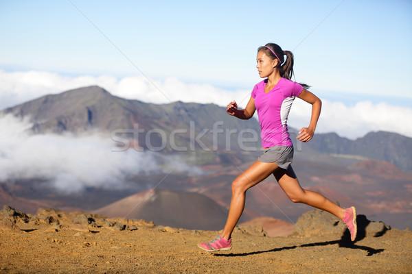 Female running athlete - woman trail runner Stock photo © Maridav