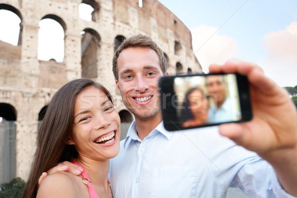 Happy travel couple taking selife, Coliseum, Rome Stock photo © Maridav