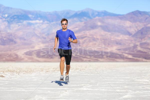 Running man - sprinting athlete runner in desert Stock photo © Maridav
