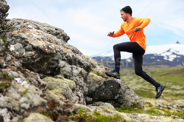 Stock photo: Sport running man in cross country trail run