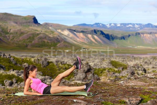 Fitness woman exercising in nature Stock photo © Maridav