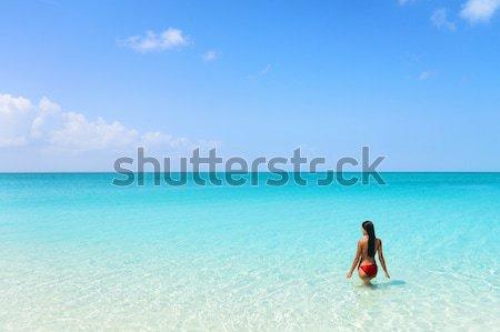 Beach holiday bikini woman swimming in blue ocean Stock photo © Maridav