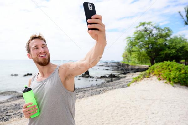 Fitness man taking selfie of himself after workout Stock photo © Maridav