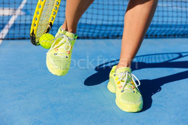 Sports athlete picking up ball with tennis racket Stock photo © Maridav