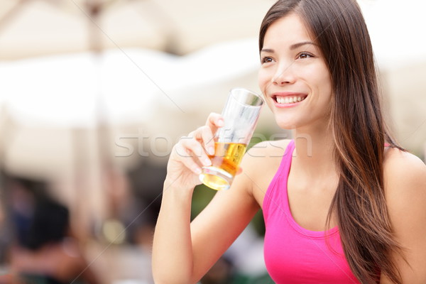 Woman on cafe drinking drink Stock photo © Maridav