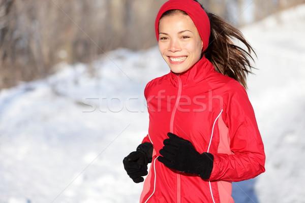 Fitness running woman in winter Stock photo © Maridav