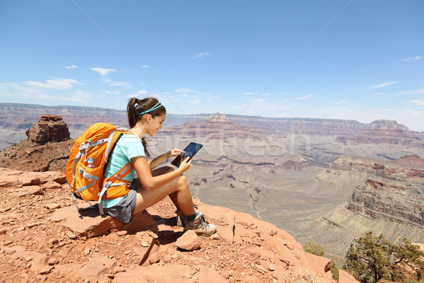 Stock photo: Tablet computer woman hiking in Grand Canyon