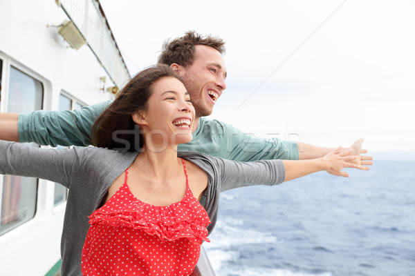 Stock photo: Romantic couple fun in funny pose on cruise ship