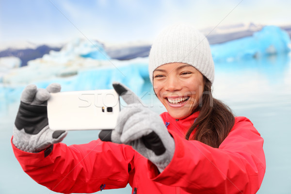 Woman taking selfie photo by Jokulsarlon Iceland Stock photo © Maridav
